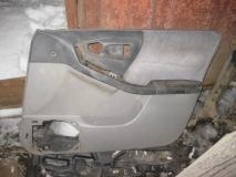Обшивка двери передней правой Subaru Forester (S10)
